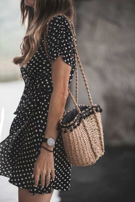 How to wear a straw bag with a polka dot dress.