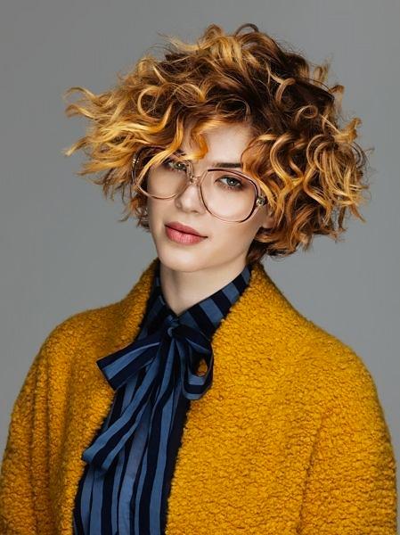 Short curly hair.