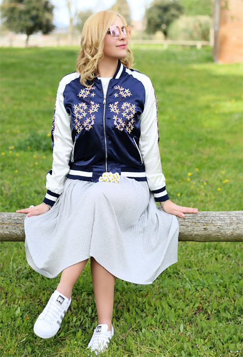 Bomber outfit and pleated skirt.