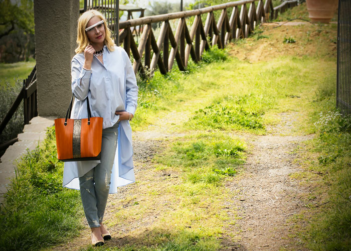 Come indossare una borsa arancione.