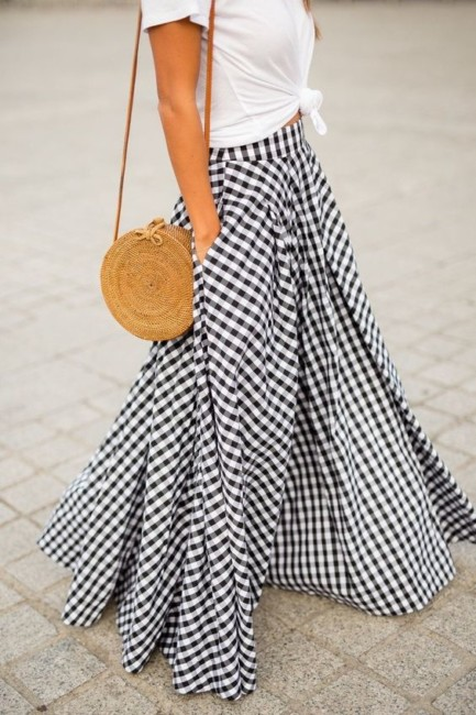 Straw bag and long skirt.